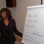 Brenda speaking in front of students